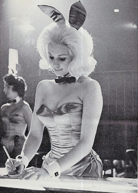 I've probably reblogged this before, but I adore vintage Playboy bunny costumes. historiful:  An unidentified Playboy bunny, c. 1962.