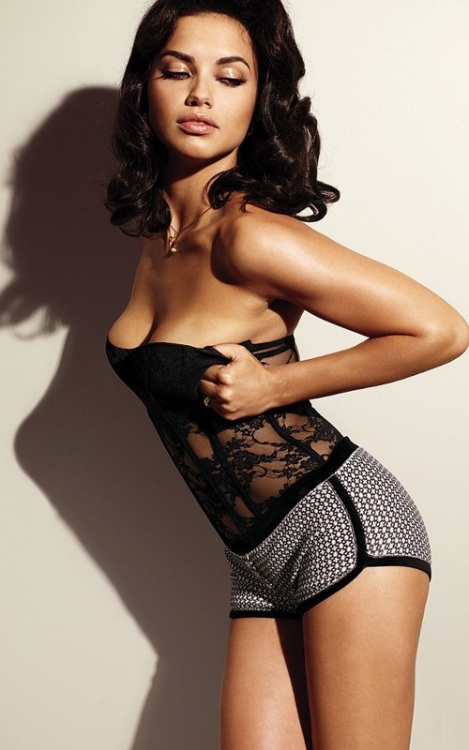 lavinialingerie:  Sexy Adriana Lima in Sheer Lace Bustier  I *love* her thicker torso. She's strong and sexy as fuck <3