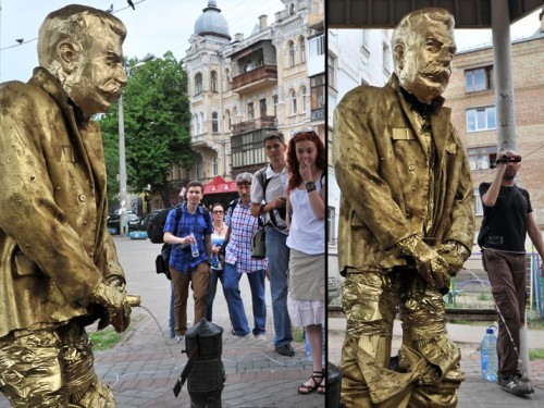 mabelmoments:  People look at a statue called Pissing Stalin Golden Monument installed by activists of Ukrainian nationalist party Svoboda in Kiev. Picture: SERGEI SUPINSKY/AFP/GettyImages