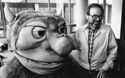 "reed-johnson:  In this Sept. 25, 1985 file photo, author Maurice Sendak poses with one of the characters from his book ""Where the Wild Things Are,"" designed for the operatic adaptation of his book in St. Paul, Minn. Sendak died, Tuesday, May 8, 2012 at Danbury Hospital in Danbury, Conn. He was 83.   :("