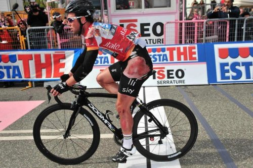 fuckyeahcycling:  Giro d'Italia 2012 | Stage 3 That's going to hurt.  A bashed and grazed Mark Cavendish crosses the line. (via Wall Photos)