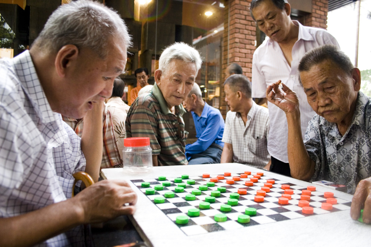 Old men gather in Chinatown for a serious game of Chinese chess.