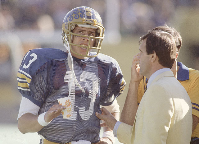 Pittsburgh QB Dan Marino talks with coach Jackie Sherrill during a 1981 game against Florida State. (Heinz Kluetmeier/SI) SI VAULT: Player of the Week - Pitt QB Dan Marino (10.12.81)
