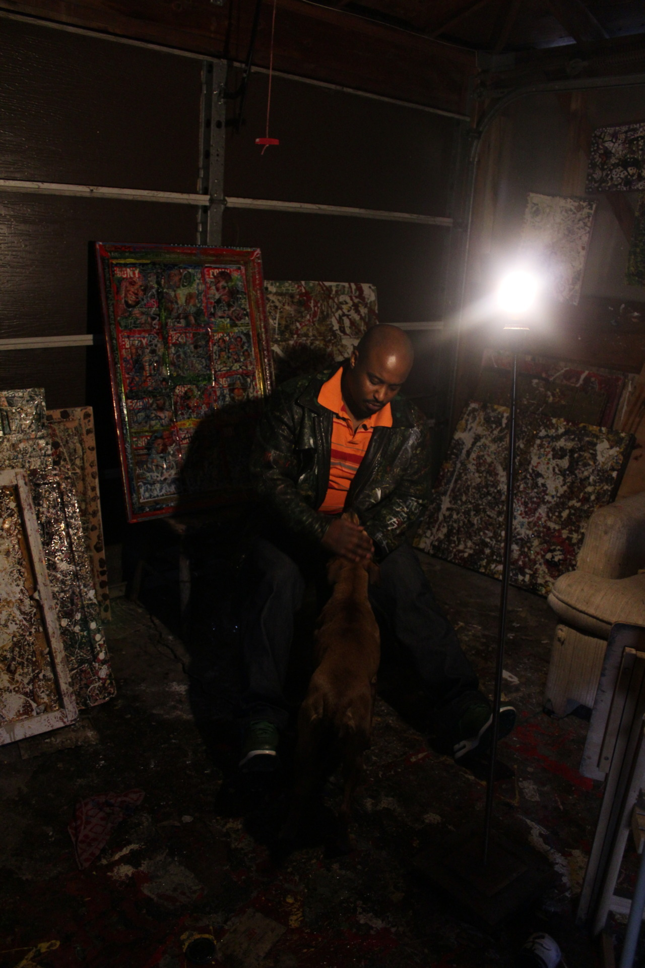Mr. Taylor and his pup in his studio Sunday
