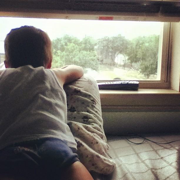 Baby watching the rain ☔👦⚡🌈 (Taken with instagram)