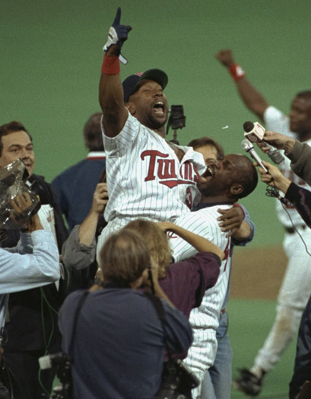 Kirby Puckett reacts after hitting a game-winning home run in the 11th inning of Game 6 of the 1991 World Series. The Twins legend made his debut on this day in 1984, smacking four singles against the Angels in a 5-0 victory. (VJ Lovero/SI) GALLERY: Top World Series Moments