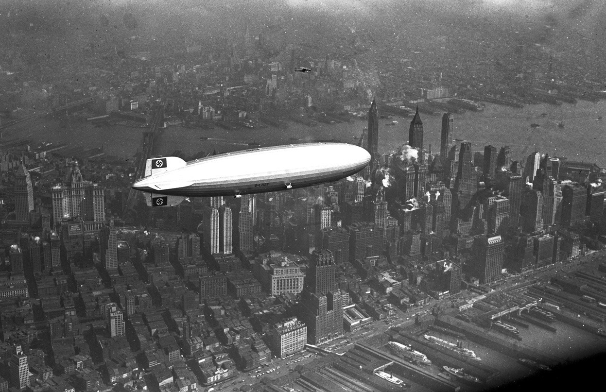 From 75 Years Since The Hindenburg Disaster, one of 34 photos. The German zeppelin Hindenburg flies over Manhattan on May 6, 1937. A few hours later, the ship burst into flames in an attempt to land at Lakehurst, New Jersey, (AP Photo)