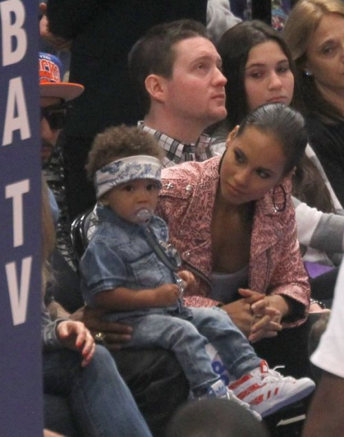 aspiringeverything:  surisburnbook:  Alicia Keys's baby, Egypt Keys-Beatz, thinks he looks really cool, but in reality, he is wearing denim on denim at a Knicks game. With a pacifier strapped to his shirt.  ha  Egypt Keys-Beatz.