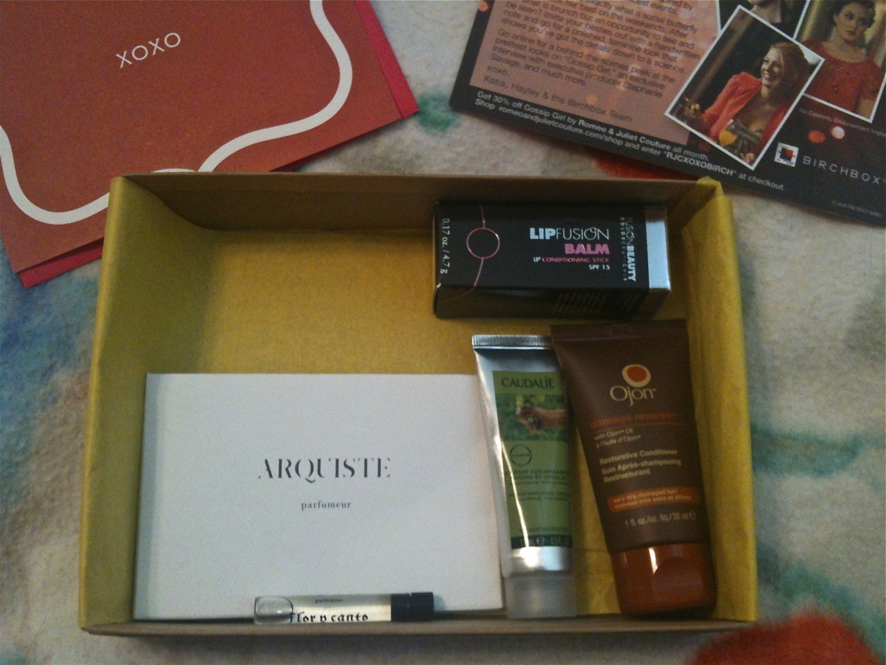 Yay for May! Gossip Girl Birchbox is here. There were 4 different themes related to GG this month. Mine was Chic Sunday Brunch.  Here's what's inside: FusionBeauty LipFusion Balm: This is the full-size $22 Ojon damage reverse Restorative Conditioner: 30ml sample $2.94 Caudalie Hand and Nail Cream: 15ml sample $3.80 Arquiste Flor y Canto scent: 1.13ml sample $3.39 Gossip Girl xoxo Notecard w/Envelope Total value: $32.13 Not bad for only $10/month!