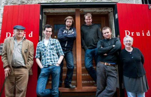 Actors Marty Rea, Aaron Monaghan, Garrett Lombard and Rory Nolan (L-R) take the stage tonight for Conversations on a Homecoming, the first of the three plays written by Tom Murphy (far left) and directed by Garry Hynes (far right) that make up Druid Theatre Company's DruidMurphy. All four actors are also performing in A Whistle in the Dark and Famine.