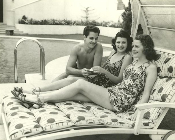 Rita Hayworth at Sunset Plaza Hotel pool in Hollywood in 1937 with Bob Hoover and Jacqueline Wells.