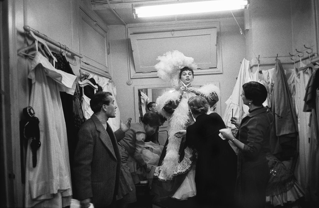 "Dec. 6, 1955: The soprano Roberta Peters tried on her gown for the third act of ""Don Pasquale"" at Eaves Costumer, 151 West 46th Street. Photo: Sam Falk/The New York Times"