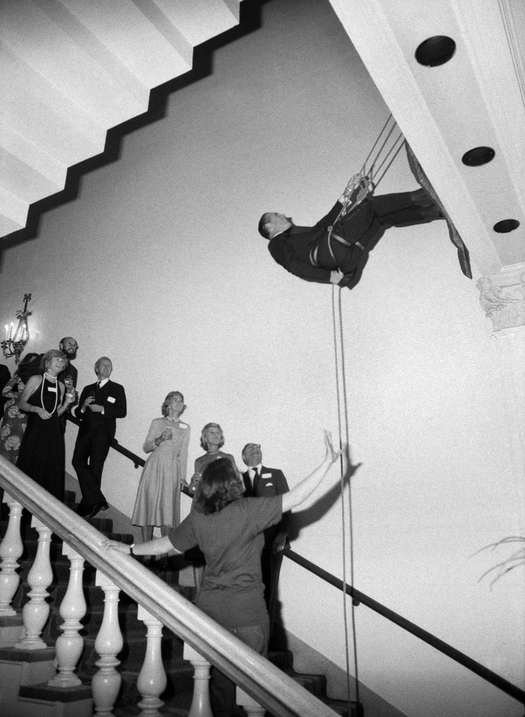 "Oct. 26, 1976: ""In Tux and Gowns, Some Outdoor Types Climb the Walls,"" was the headline for an article that accompanied this photo of a benefit dinner for Outward Bound at the Plaza Hotel. ""The loudest cheers came from the women, since the crowd of 500 included several corporate wives who have been off climbing mountains without their mates,"" the reporter wrote. The evening's only mishap? Somebody tripped on a loose carpet. Photo: Chester Higgins Jr./The New York Times"
