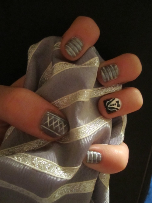 swirl nails, they match my dress :]there was a corset (the thumb matches) and then a random tux because it's cute