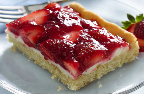 Strawberries and Cream Dessert Squares Recipe by Betty Crocker Recipes on Flickr.Via Flickr: Crust 1 pouch (1 lb 1.5 oz) Betty Crocker® sugar cookie mix 1/2 cup butter or margarine, softened 1 egg Filling 1 cup white vanilla baking chips (6 oz) 1 package (8 oz) cream cheese, softened Topping 4 cups sliced fresh strawberries 1/2 cup sugar 2 tablespoons cornstarch 1/3 cup water 10 to 12 drops red food color, if desired Directions: 1. Heat oven to 350°F. Spray bottom only of 15x10x1- or 13x9-inch pan with cooking spray. In large bowl, stir cookie mix, butter and egg until soft dough forms. Press evenly in bottom of pan. Bake 15 to 20 minutes or until light golden brown. Cool completely, about 30 minutes. 2. In small microwavable bowl, microwave baking chips uncovered on High 45 to 60 seconds or until chips are melted and can be stirred smooth. In medium bowl, beat cream cheese with electric mixer on medium speed until smooth. Stir in melted chips until blended. Spread mixture over crust. Refrigerate while making topping. 3. In small bowl, crush 1 cup of the strawberries. In 2-quart saucepan, mix sugar and cornstarch. Stir in crushed strawberries and 1/3 cup water. Cook over medium heat, stirring constantly, until mixture boils and thickens. Stir in food color. Cool 10 minutes. Gently stir in remaining 3 cups strawberries. Spoon topping over filling. Refrigerate 1 hour or until set; serve within 4 hours. Store covered in refrigerator.www.bettycrocker.com/cookies