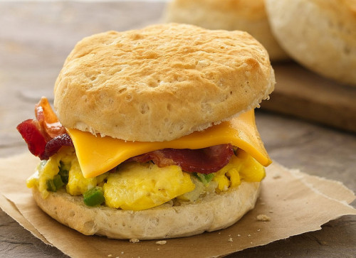 RECIPE: Breakfast Biscuit Sandwiches by Pillsbury.com on Flickr.Via Flickr:INGREDIENTS 4 Pillsbury® Grands!® frozen buttermilk biscuits (from 4 lb 11-oz bag) 2 eggs 2 tablespoons milk 1/8 teaspoon salt 1/8 teaspoon pepper 2 tablespoons shredded sharp Cheddar cheese 4 slices packaged precooked bacon, cut in half crosswiseDIRECTIONS 1. Heat oven to 375°F. Bake biscuits as directed on bag. 2. Meanwhile, spray 9-inch glass pie plate with cooking spray. In small bowl, mix eggs, milk, salt and pepper. Pour into pie plate. Microwave uncovered on High about 1 minute 30 seconds, lifting edge with spatula to let egg mixture run underneath every 30 seconds, until set. Fold in half; if still wet, microwave 30 seconds longer. Sprinkle with cheese. Cover with plastic wrap. 3. Microwave bacon as directed on package. 4. Split warm biscuits horizontally; place on 4 individual serving plates. Cut eggs into 4 wedges. Place eggs and bacon on bottom halves of biscuits. Cover with top halves of biscuits.