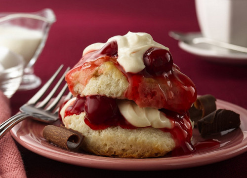 Recipe: Cherry Valent Shortcakes by Pillsbury.com on Flickr.Via Flickr: DESCRIPTION Make an extra special dessert for two with easy frozen biscuits and a luscious cherry topping.  INGREDIENTS 2 Pillsbury® Grands!® Frozen Buttermilk Biscuits (from 25-oz bag) 2 teaspoons packed brown sugar 1/4 cup sour cream 2 tablespoons whipping cream 1 teaspoon butter or margarine, melted 1/2 teaspoon sugar 2/3 cup cherry pie filling (from 21-oz can) DIRECTIONS 1.Heat oven to 375°F. Bake biscuits as directed on bag. 2.Meanwhile, in small bowl, sprinkle brown sugar over sour cream; let stand 2 minutes. Beat in whipping cream on high speed until slightly thickened. Refrigerate until serving time. 3.Brush hot biscuits with melted butter; sprinkle with sugar. Cool 5 minutes. Split biscuits; fill and top with pie filling and sour cream mixture. High Altitude (3500-6500 ft): No change.