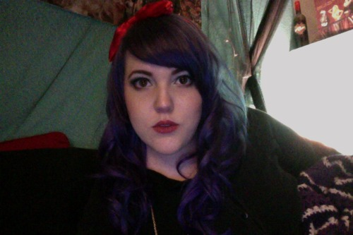 Here's a picture of my (dark) purple hair! I like it. Its' more violet/blue in the sun…very different from the lavender I had before. I'll probably take actual pictures sometime this week. :]