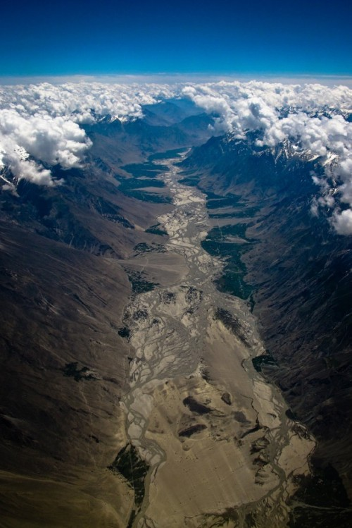 elegantbuffalo:  Parting of the clouds—Himalayas, Pakistan. (Photo taken by Kristen Elsby)