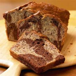 thefitty:  searchingforbliss:  Marbled-Chocolate Banana Bread  Yield: 1 loaf, 16 slices Ingredients 2 cups all-purpose flour (healthier substitute: wheat flour) 3/4 teaspoon baking soda 1/2 teaspoon salt 1 cup sugar (healthier substitutes: truvia, extra ripe bananas, applesauce and/or honey) 1/2 cup egg substitute (or egg whites) 1/3 cup plain low-fat yogurt 1/2 cup semisweet chocolate chips Cooking spray Preparation Preheat oven to 350°. Lightly spoon flour into dry measuring cups, and level with a knife. Combine the flour, baking soda, and salt, stirring with a whisk. Place sugar and butter in a large bowl; beat with a mixer at medium speed until well blended (about 1 minute). Add banana, egg substitute, and yogurt; beat until blended. Add flour mixture; beat at low speed just until moist. Place chocolate chips in a medium microwave-safe bowl, and microwave at HIGH 1 minute or until almost melted, stirring until smooth. Cool slightly. Add 1 cup batter to chocolate, stirring until well combined. Spoon chocolate batter alternately with plain batter into an 8 1/2 x 4 1/2-inch loaf pan coated with cooking spray. Swirl batters together using a knife. Bake at 350° for 1 hour and 15 minutes or until a wooden pick inserted in center comes out clean. Cool 10 minutes in pan on a wire rack; remove from pan. Cool completely on wire rack. Nutrition* Calories: 183 Fat: 2.7g Protein: 3.1g Carbohydrate: 33.4g Fiber: 1.3g *Nutrition will vary if you use other ingredients, but definitely for the better ;) If you use extremely ripe bananas, you won't need to add any sugar to create a sweet loaf!  (via imgTumble)
