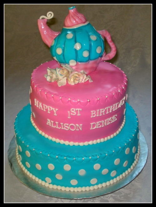 Vancouver Cake Designer creates this super cute and girlie Tea Pot Cake for a birthday girls tea party!  Cake was made to look like the client's invitation. If you are located in the Vancouver, BC, Canada area and are looking to get a cake for a special event, please contact Vancouver Cakes aka Lyttle Bake Shop today!  We book up fast!  www.vancouvercakes.com Email: info@lyttlebakeshop.com Vancouver's Custom Cake Designer since 2010!