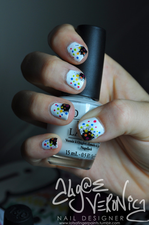 lotsafingerpaints:  Rainbow on Black Splash
