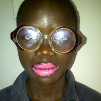 talk about coke bottle glasses… and the lipstick… no comment