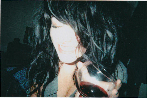 samdesantis:  film (by samdesantis) really old photo of me drinkin some wine   This photo is so old and so many things have changed and I just wonder how the people are that were in my life at this point.