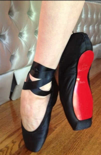 Dita's custome made Louboutin ballet shoes.