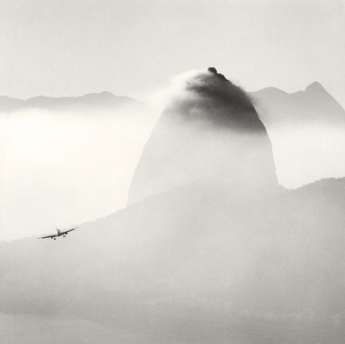 minusmanhattan:  Plane and Sugar Loaf Mountain, Rio De Janeiro, Brazil by Michael Kenna.