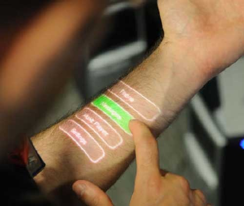 Turn your Body into a Touchscreen Interface It could become part of a skin-based interface that effectively turns your body into a touchscreen