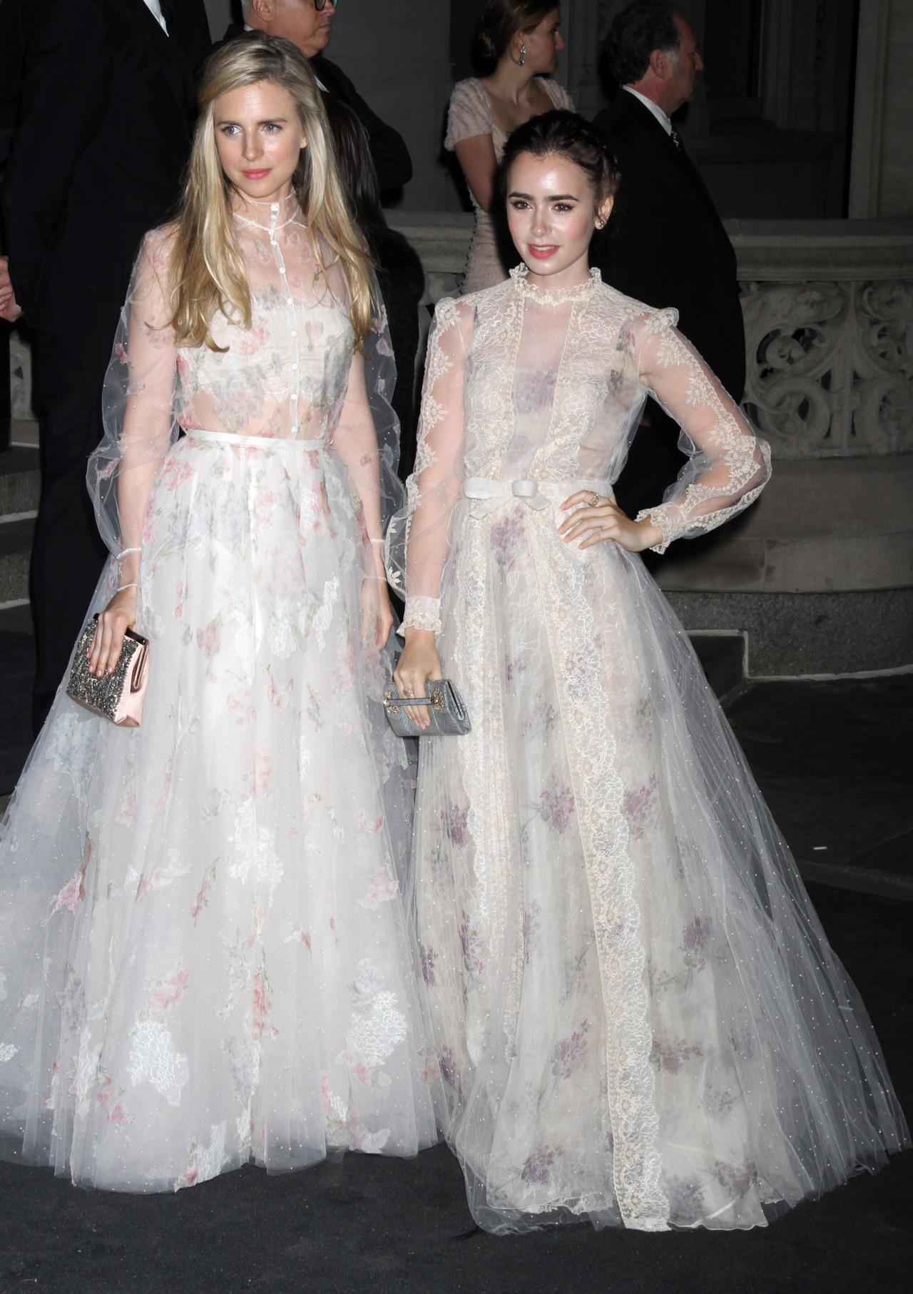 suicideblonde:  Brit Marling and Lily Collins at the Met Gala afterparty, May 7th Seeing two of these Valentino dresses together is to fully appreciate the beauty of this collection.  (thanks to everyone who let me know who Brit Marling is!)