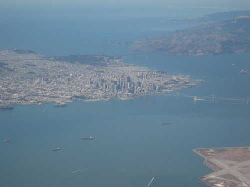 The view of San Francisco from above, SFO-DEN, you can see the very edge of OAK in the corner =)