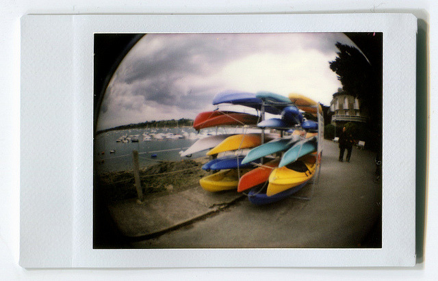 BoatsBoatsBoats on Flickr.Colorful boats waiting to be used. Diana F, Instant Back, Fish Eye lens. © Bree Sage http://seebreebefree.wordpress.com/
