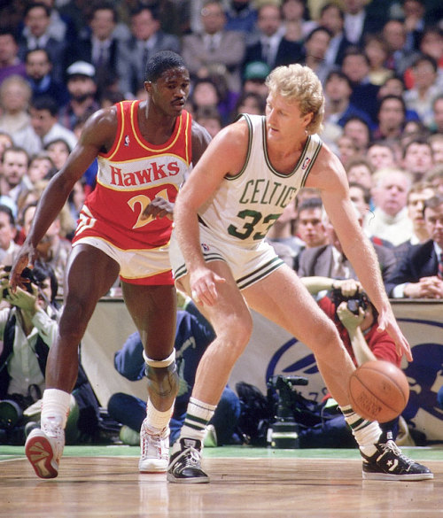 siphotos:  Larry Bird backs Dominique Wilkins into the post during Game 7 of the 1988 Eastern Conference Semifinals. Bird scored 34 points, 20 in the fourth-quarter, while Wilkins poured in 47 in a losing effort as Boston advanced to play Detroit in the Eastern Conference Finals. Are the Celtics and Hawks heading to another memorable Game 7? The Hawks survived on Tuesday with a 87-86 victory to force a Game 6 on Thursday. (Manny Millan/SI) TROCCHI: Horford fuels Hawks to victory GALLERY: Rare Photos of Larry Bird