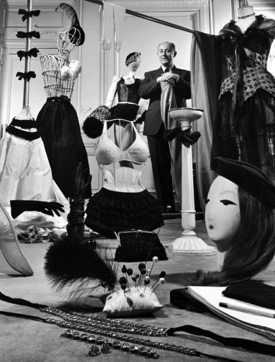 life:  Designer Christian Dior in his Paris salon, 1948. See more here.