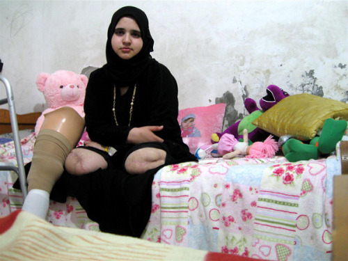 unicef:  CAN YOU SEE ME? Jamila (age 15) sits at home in Gaza City. She lost both her legs, and her sister, Shaza, was killed during the December 2008-January 2009 Israeli military incursion. A missile hit their home as they played on the roof. The one-month conflict killed 1,300 Gazans, including 350 children. Jamila's photograph was taken by Rana, 18, during a UNICEF-organized children's photography workshop. Occupied Palestinian Territory, 2009 © UNICEF/Rana Matar http://www.unicef.org