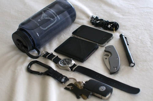 everydaycarry:  submitted by vikingmidgets  I really enjoy reading your blog and getting to see how diverse everyones load out is.  So here is currently what I usually have on me. -Dan - 32oz Nalgene bottle(I drink at least one every day)- Keys w/gerber shard(would love an atwood and toying with the idea of a second light on the keys)- Citizen BM6400 on NATO strap (cheap durable and easy to read)- Slimmy Wallet- iPhone 4- Spyderco Sage 2 Titanium- 4sevens Preon 2- Shure e2c IEMs (I intend to replace these with custom molded IEMs soon)  Editor's Note: Hey Dan, I appreciate your support. Let's take a look at your EDC… It's good to see that you keep a bottle, hydration is really important for daily health, and having water could save your life one day, actually. I just wonder how you carry something like that. As for your keychain, some Atwoods would definitely add different functionalities but also keep an eye out on Leatherman, word on the street is that they acquired PocketToolX and should have some more affordable keychain one piece multitool offerings to consider. A second light is not a bad idea either, considering your main light is a little long — a small twisty light should complement it well (if you like 4sevens, maybe a Mini CR2 if you can manage the bulk). But in its current configuration, your keychain seems lightweight enough to handle everything on that non-locking carabiner, assuming you pocket tuck it. Good choice of watch, you bring up a good point about it being easy to read. Arabic numerals would help out with that considering the small case diameter. Your knife is a great EDC, not too large with a nice blade shape, excellent materials and lock. And yes, e2cs are a little dated but I see you're in the market to upgrade. Nice carry over all and thanks for sharing.