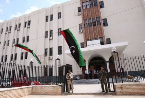 "AFP | Libya govt starts to get tough on road to democracy   TRIPOLI — The tendency to resort to the arms which ousted Moamer Kadhafi poses a roadblock to democracy in the new Libya, analysts warn, while recognising the government's growing capacity to defuse crises. Libyan authorities resorted to force on Tuesday for the first time to repel dozens of armed men who had laid siege to Prime Minister Abdel Rahim al-Kib's offices to demand stipends and medical treatment for the war wounded. ""It is not just rogue elements but a pernicious logic that prevails across the country,"" Middle East specialist Karim Bitar told AFP, warning that Libya risks becoming swept by instability spreading across the Sahel region. ""The situation is very worrying,"" he said in reference to the latest attack on the government that left one dead and four people wounded. Libya's new rulers face almost daily protests from armed ex-fighters who want financial and other benefits in recognition of their role in toppling the regime of slain leader Kadhafi in 2011. The government has counted on dialogue with demonstrators, only to be cowed into signing checks by former rebels flaunting their firepower or blocking access to oil companies and institutions. ""The government will not be able to hold on for long if it keeps yielding to blackmail and buying the allegiance of militias with hard cash,"" Bitar said. In televised remarks late Tuesday, Kib adopted a tough tone, vowing that his government would ""not negotiate under the threat of arms"" and warning of the use of force if necessary. Tripoli High Security Committee head Khaled Besher said 14 assailants were arrested following the worst attack in Tripoli against Libya's new rulers. How the government deals with militias, made up of former rebels who fought against Kadhafi's regime, could make or break Libya's transition to democracy, analysts say. ""People are not going to let go of their arms unless they feel that they are part of the political process,"" said an Arab pro-democracy activist in Tripoli, while warning that hurried elections could pave the way for more violence. Strengthening state institutions, tackling rogue militias and dealing fairly with former supporters of Kadhafi's regime are steps the interim authorities must take to bring about normalisation, he said. ""With all the problems, the Libyan leadership has succeeded to a large extent in defusing the tensions,"" said the activist, asking not to be named. Peter Cole of the International Crisis Group praises the government's handling of the latest crisis, noting the security forces used to intervene had been handpicked by the interior ministry. FULL ARTICLE (AFP)"