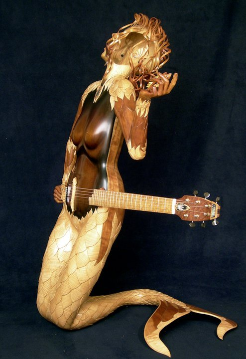 :Mermaid- Andy Manson. . Andy Manson, perhaps best known as the luthier who built John Paul Jones' triple-necked guitar during the Led Zeppelin years, spent three years creating his Mermaid Guitar. Manson refers to this as a musical sculpture, as opposed to a guitar. . The lifesize body is constructed of an amazing number of woods, including mahogany, walnut, satinwood, snakewood, sycamore, willow, and cherry. Manson's shop is in Portugal, and the Mermaid is for sale. To hear the guitar being played by Manson, go to http://www.youtube.com/watch?v=wd8IfxYvbUE.