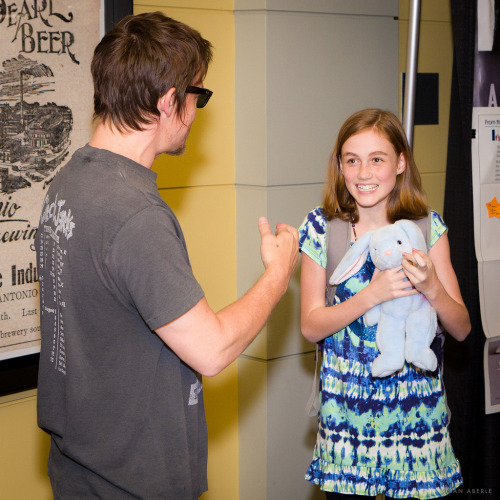 ianaberle:  Norman Reedus talks with his Walking Dead costar, Madison Lintz Love this candid photo of Norman Reedus and Madison Lintz from Texas Frightmare Weekend.
