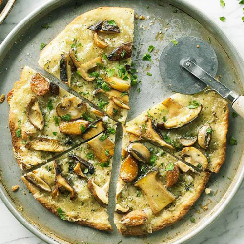 Daily Dish: This tasty Mushroom-Garlic Pizza is topped with shitake and cremini mushrooms, caramelized garlic, and Gruyere cheese.