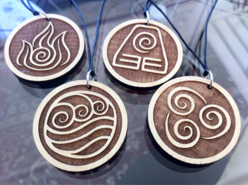 Commissioned necklaces of Avatar elemental symbols
