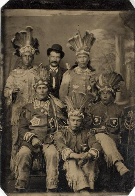ca. 1875, [tintype portrait of five men in Native American dress, and one in western attire] via the International Center of Photography
