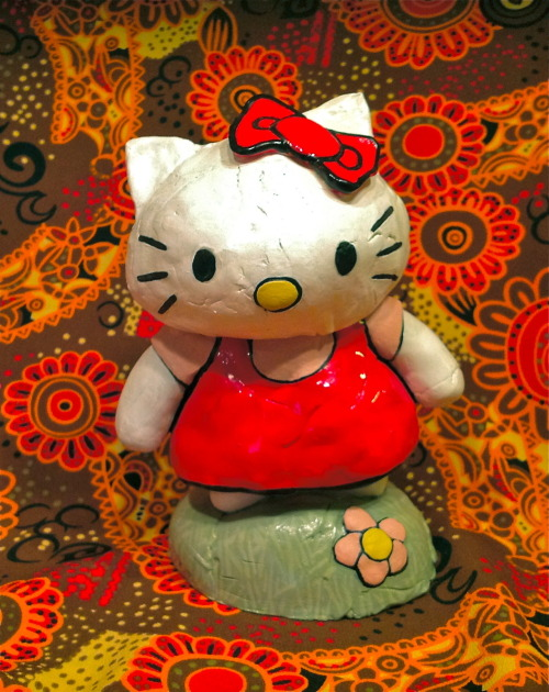 pixel404:  Hello Kitty is feeling a bit disheveled today! Boohoo, Kitty! Take a nap… isn't that what cats are supposed to do?  Love kitty