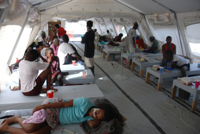 "Haiti Unprepared in the Face of Resurgent Cholera   Cholera cases are on the rise in Haiti following the onset of the rainy season, and the country is not adequately prepared to combat the deadly disease, the international medical humanitarian organization MSF said today.  ""Too little has been done in terms of prevention to think that cholera would not surge again in 2012,"" said Gaëtan Drossart, MSF head of mission in Haiti. ""It is concerning that the health authorities are not better prepared and that they cling to reassuring messages that bear no resemblance to reality. There are many meetings going on between the government, the United Nations and their humanitarian partners, but there are few concrete solutions,"" he said.Photo: Patients affected by cholera receive treatment at an MSF cholera treatment center in Port-au-Prince. Haiti 2011 © Frederik Matte/MSF"
