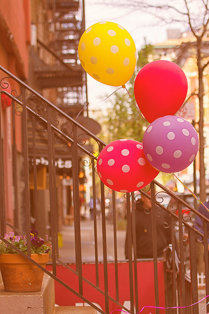 balloons on a fence~ macdougal street~ nyc by ~mimo~ on Flickr.