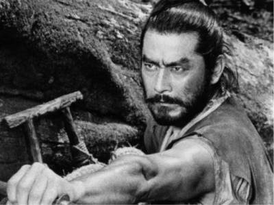 "The Hidden Fortress     1958    Akira Kurosawa ""Hide a stone among stones and a man among men."" A princess must sneak across enemy lines with her gold to find a safe place to rebuild her clan. She is helped along by her bodyguard and two peasants. Great movie, beautiful cinematography, and a great story. The two peasants provide a lot of humor."