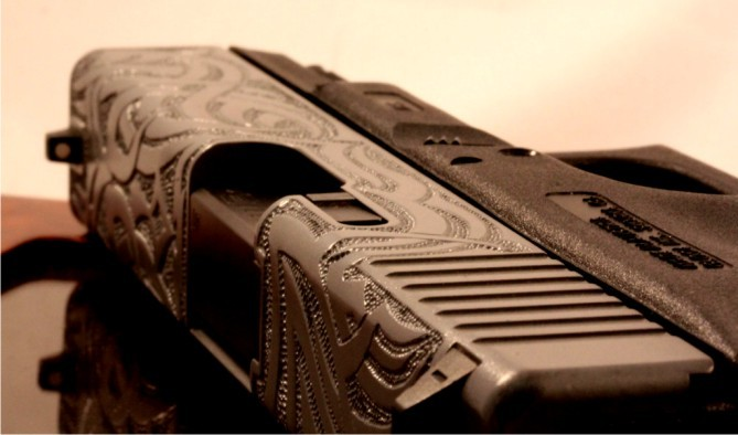 weaponzone:  Check out the detailed work on this Glock 23!See more at : Otto Carter Semi-Autos Credit: Otto Carter