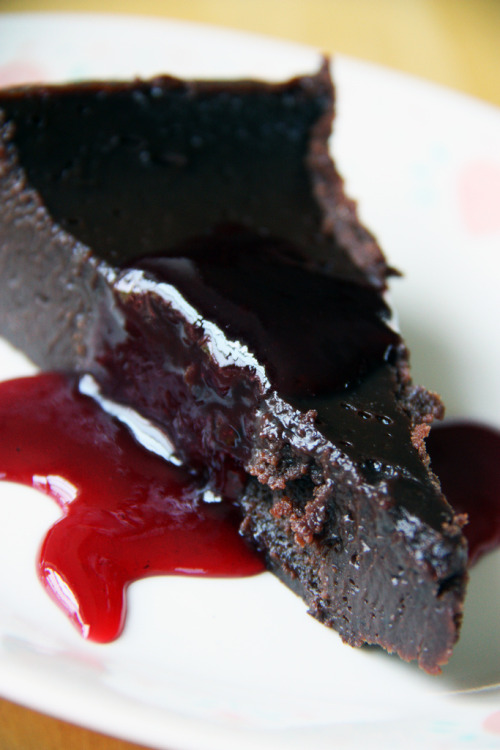 f-word:  flourless chocolate cake with raspberry reduction photo by aschloop